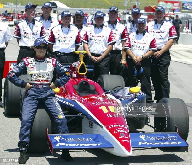 Danica Patrick driver of the Rahal Letterman Racing Argent Pioneer Panoz Honda with her Rahal/Letterman team after qualifying on Pole for the IRL...