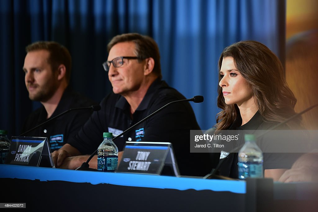 Danica Patrick, driver of the #10 Stewart-Haas Racing Chevrolet, and Dave and Sam Marson, co-founders of Nature's Bakery, announce a multiyear deal partnership during a press conference on August 18, 2015 in Kannapolis, North Carolina. The partnership will begin with the 2016 NASCAR Sprint Cup Series season.