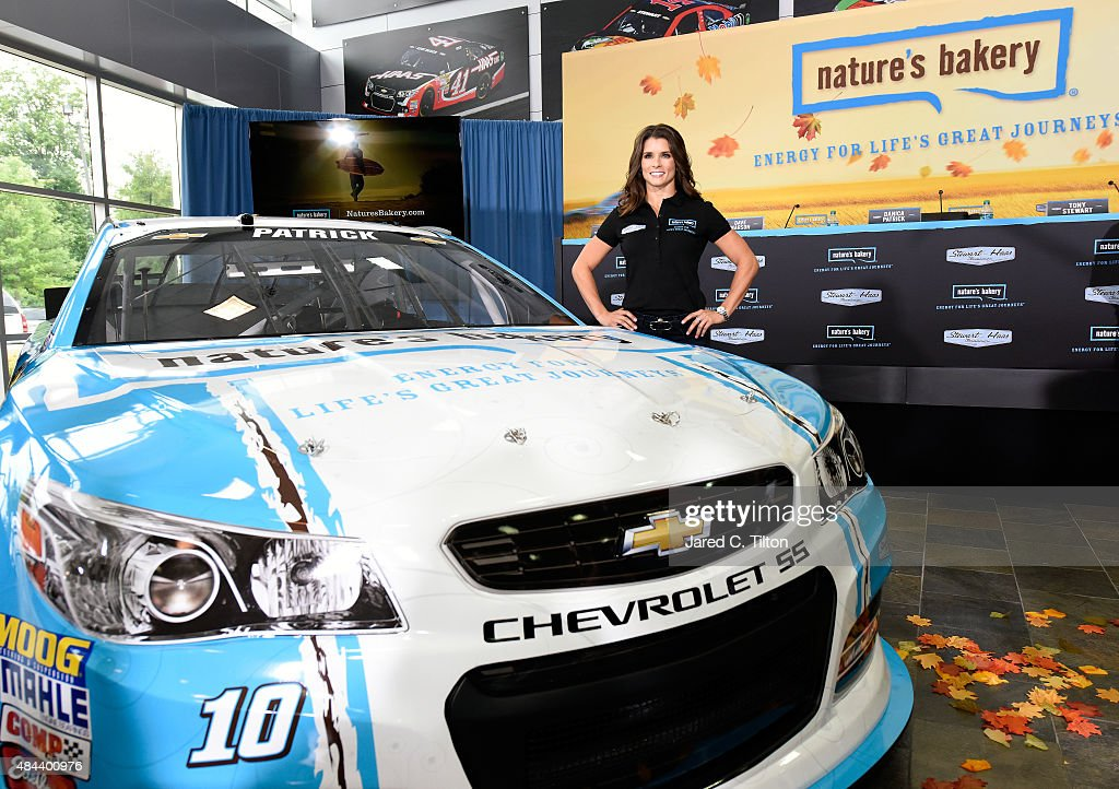 Danica Patrick, driver of the #10 Stewart-Haas Racing Chevrolet, poses for a photo opportunity after she announced a multiyear deal partnership with Nature's Bakery during a press conference on August 18, 2015 in Kannapolis, North Carolina. The partnership will begin with the 2016 NASCAR Sprint Cup Series season.