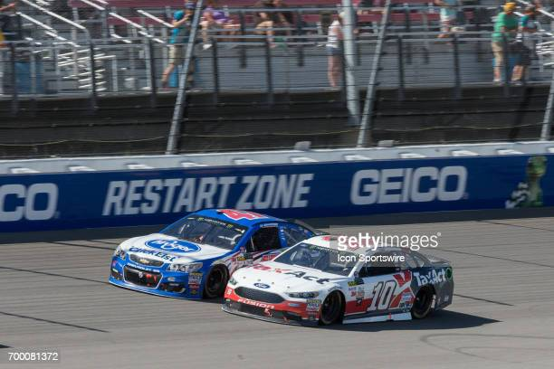 Danica Patrick driver of the TaxAct Ford and AJ Allmendinger driver of the Kroger ClickList Chevrolet race during the Monster Energy Cup Series...