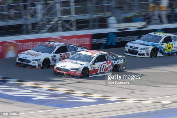 Danica Patrick driver of the TaxAct Ford and Matt DiBenedetto driver of the Keen Parts Ford race during the Monster Energy Cup Series Firekeepers...