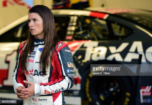 Danica Patrick driver of the TaxAct Ford stands in the garage during practice for the Monster Energy NASCAR Cup Series Advance Auto Parts Clash on...