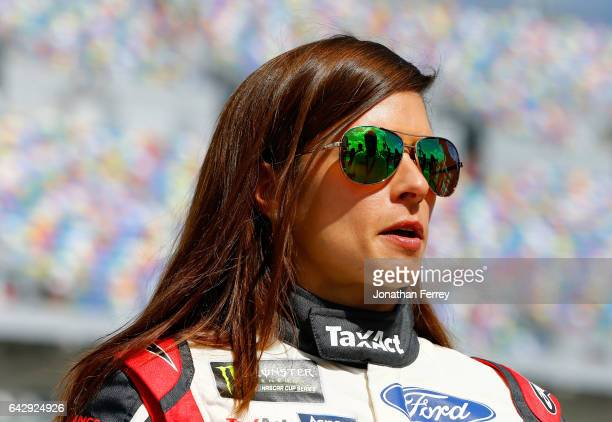Danica Patrick driver of the TaxAct Ford takes part in prerace ceremonies for the weather delayed Monster Energy NASCAR Cup Series Advance Auto Parts...
