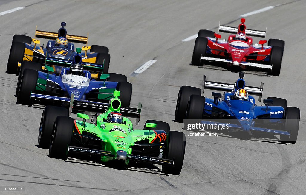 Danica Patrick, driver of the #7 Team GoDaddy Andretti Autosport Dallara Honda leads a pack of cars during the IZOD IndyCar Series Kentucky Indy 300 on October 2, 2011 at Kentucky Speedway in Sparta, Kentucky.