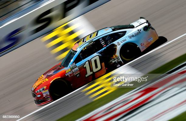 Danica Patrick driver of the Wonder Woman/One Cure Ford practices for the Monster Energy NASCAR Cup Series Go Bowling 400 at Kansas Speedway on May...