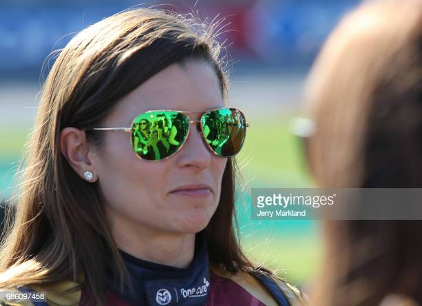Danica Patrick driver of the Wonder Woman/One Cure Ford stands by her car during the Monster Energy NASCAR Open at Charlotte Motor Speedway on May 20...