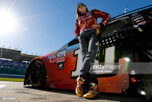 Danica Patrick driver of the Wonder Woman/One Cure Ford wait in the pits during qualifying for the Monster Energy NASCAR Cup Series Go Bowling 400 at...