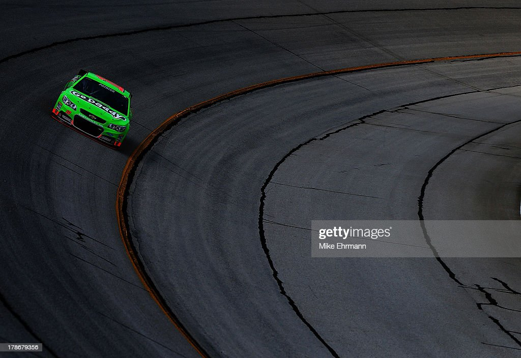 <a gi-track='captionPersonalityLinkClicked' href=/galleries/search?phrase=Danica+Patrick&family=editorial&specificpeople=183352 ng-click='$event.stopPropagation()'>Danica Patrick</a> drives the #10 GoDaddy.com Chevrolet during practice for the NASCAR Sprint Cup Series AdvoCare 500 at Atlanta Motor Speedway on August 30, 2013 in Hampton, Georgia.