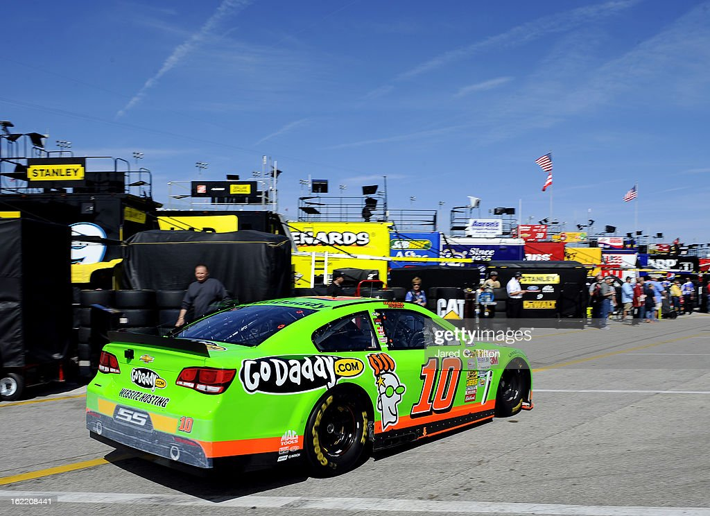 Danica Patrick drives the #10 GoDaddy.com Chevrolet through the garage area during practice for the NASCAR Sprint Cup Series Daytona 500 at Daytona International Speedway on February 20, 2013 in Daytona Beach, Florida.