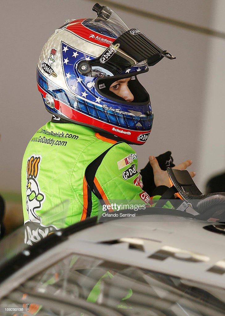 Danica Patrick gets out of her car while testing during NASCAR Sprint Cup Series Preseason Thunder at Daytona International Speedway in Daytona Beach, Florida, Thursday, January 10, 2013.