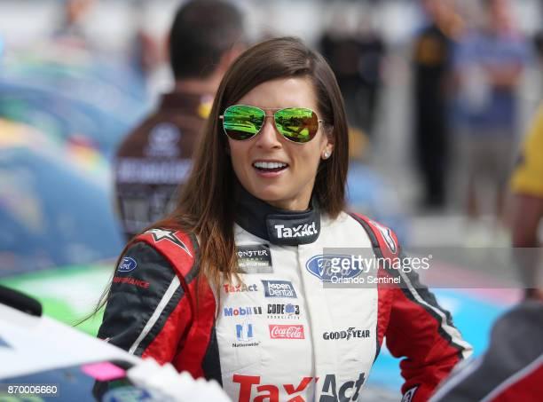 Danica Patrick prepares to get into her race car before the Clash at Daytona NASCAR race on February 19 at Daytona International Speedway in Daytona...