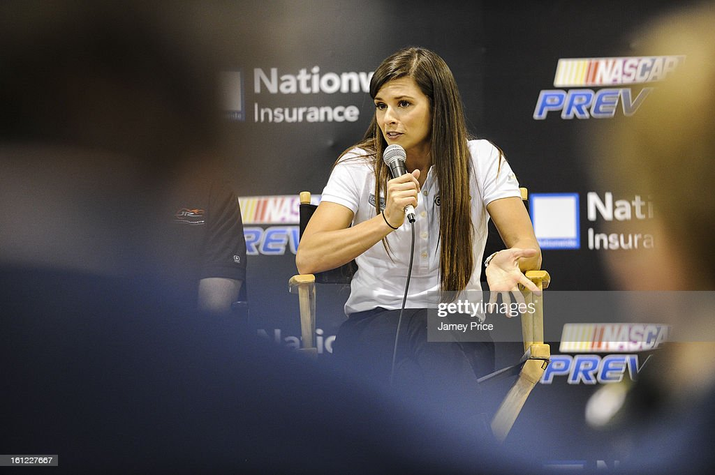 <a gi-track='captionPersonalityLinkClicked' href=/galleries/search?phrase=Danica+Patrick&family=editorial&specificpeople=183352 ng-click='$event.stopPropagation()'>Danica Patrick</a> speaks to fans on Saturday afternoon at the NASCAR Hall of Fame on February 9, 2013 in Charlotte, North Carolina.