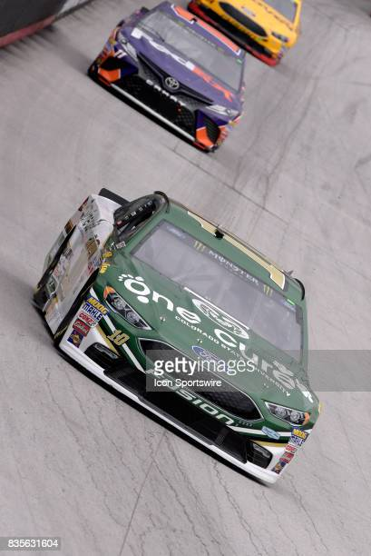Danica Patrick StewartHaas Racing Ford Fusion dives into turn three during the practice session for the Bass Pro Shops NRA Night Race on August 18 at...