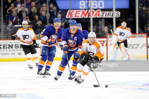 Danick Martel of the Philadelphia Flyers chases after the puck in the third period against the New York Islanders during their game at Barclays...