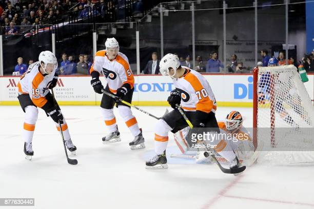 Danick Martel of the Philadelphia Flyers defends against the New York Islanders in the second period during their game at Barclays Center on November...