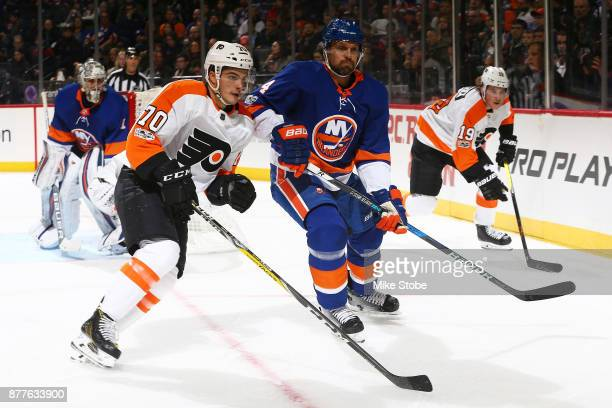 Danick Martel of the Philadelphia Flyers skates against Dennis Seidenberg of the New York Islanders in his first NHL game at Barclays Center on...