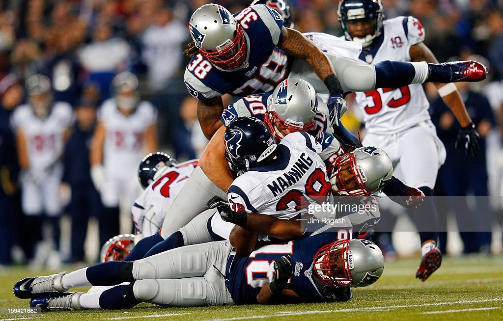 Danieal Manning #38 of the Houston Texans gets tackled by Matthew Slater #18, Niko Koutouvides #90, Marquice Cole #23, and Brandon Bolden #38 of the New England Patriots during the 2013 AFC Divisional Playoffs game at Gillette Stadium on January 13, 2013 in Foxboro, Massachusetts.