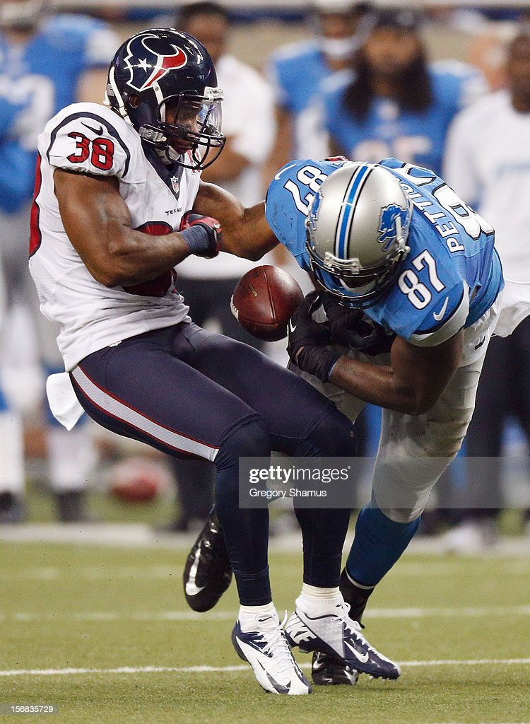 Danieal Manning #38 of the Houston Texans strips Brandon Pettigrew #87 of the Detroit Lions of the ball after a Pettigrew overtime catch at Ford Field on November 22, 2012 in Detroit, Michigan. Houston won the game 34-31.
