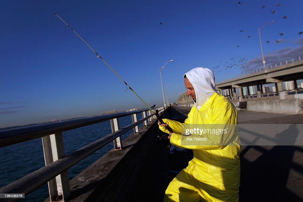 Daniel Acosta bundles up against the cool weather as he fishes on January 4, 2012 in Miami, Florida. South Florida experienced one of the coolest days of the winter season last night but temperatures are expected to warm up.