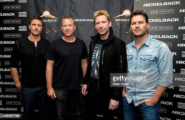 Daniel Adair Chad Kroeger Mike Kroeger and Ryan Peake of Nickelback pose at the special announcement and live performance at the House of Blues on...