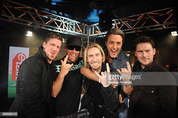 Daniel Adair Mike Kroeger Chad Kroeger and Ryan Peake of Nickelback with Ben Mulroney backstage in the E Talk Lounge at the 2009 Juno Awards at...