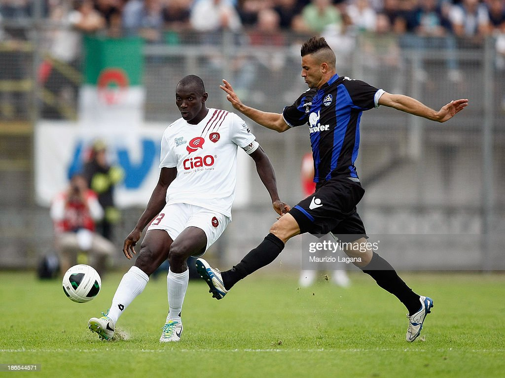 Daniel Adejo (L) of Reggina competes for the ball with <a gi-track='captionPersonalityLinkClicked' href=/galleries/search?phrase=Abdelkader+Ghezzal&family=editorial&specificpeople=5906444 ng-click='$event.stopPropagation()'>Abdelkader Ghezzal</a> of Latina during the Serie B match between US Latina and Reggina Calcio at Stadio Domenico Francioni on November 1, 2013 in Latina, Italy.