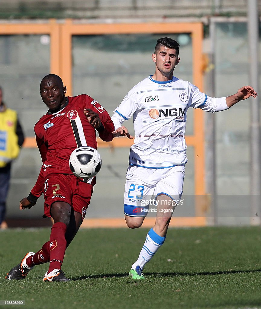 Daniel Adejo (L) of Reggina competes for the ball with Elseid Hysaj of Empoli during the Serie A match between Reggina Calcio and Empoli FC at Stadio Oreste Granillo on December 30, 2012 in Reggio Calabria, Italy.