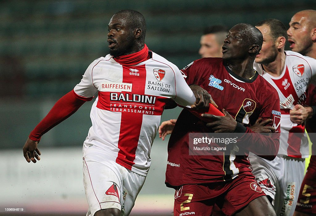 Daniel Adejo (R) of Reggina fights Yannick Ndjeng of Sion during the friendly match between Reggina Calcio and FC Sion on January 18, 2013 in Reggio Calabria, Italy.