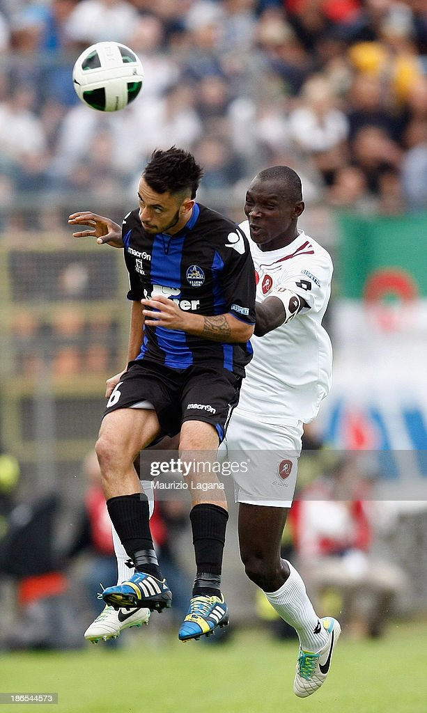 Daniel Adejo (R) of Reggina jumps for the ball with Daniele Maltese of Latina during the Serie B match between US Latina and Reggina Calcio at Stadio Domenico Francioni on November 1, 2013 in Latina, Italy.