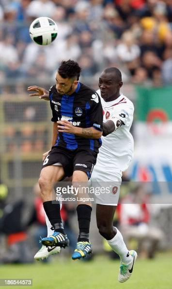 Daniel Adejo of Reggina jumps for the ball with Daniele Maltese of Latina during the Serie B match between US Latina and Reggina Calcio at Stadio...