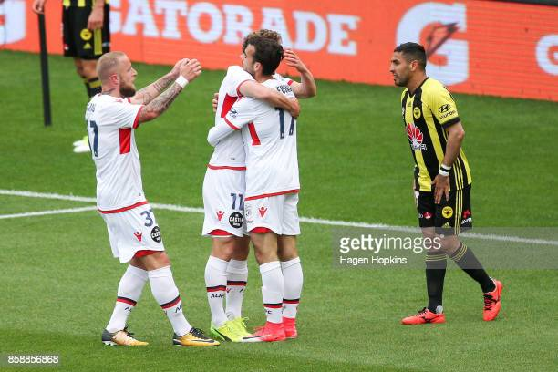 Daniel Adlung Johan Absalonsen and Nikola Mileusnic of Adelaide United celebrate a goal during the round one ALeague match between Wellington Phoenix...
