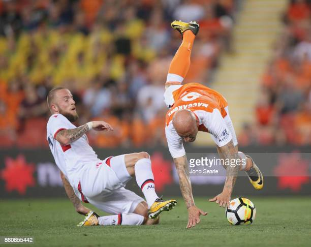 Daniel Adlung of Adelaide fouls Massimo Maccarone of Brisbane during the round two ALeague match between the Brisbane Roar and Adelaide United at...