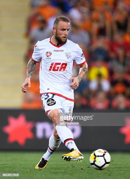 Daniel Adlung of Adelaide United passes the ball during the round two ALeague match between the Brisbane Roar and Adelaide United at Suncorp Stadium...