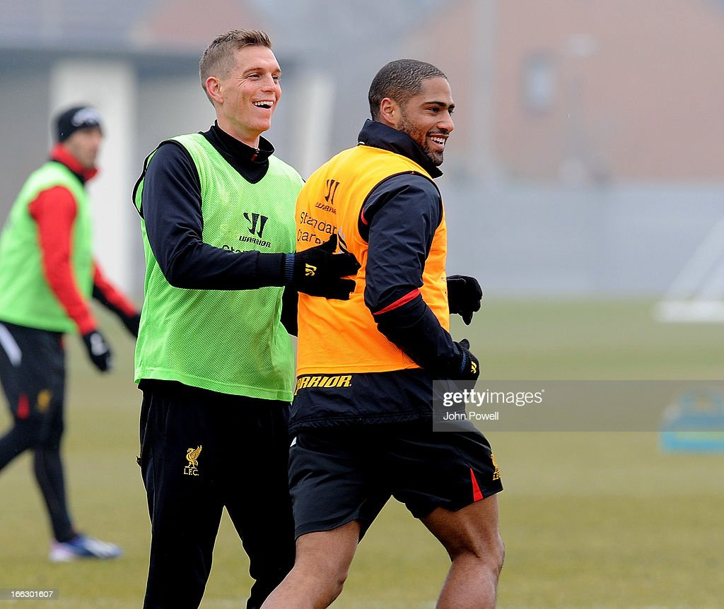 Daniel Agger and Glen Johnson of Liverpool in action during a training session at Melwood Training Ground on April 11, 2013 in Liverpool, England.