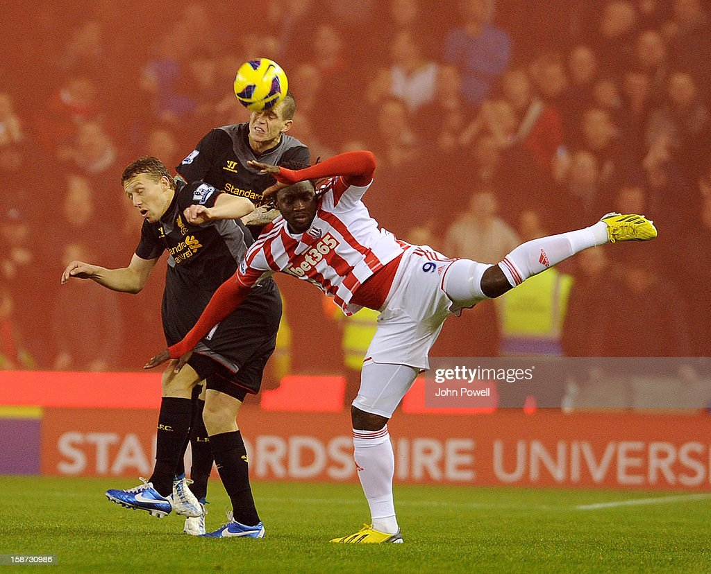 Daniel Agger and Lucas Leiva of Liverpool goes up with Kenwyne Jones of Stoke City during the Barclays Premier League match between Stoke City and Liverpool at Britannia Stadium on December 26, 2012 in Stoke on Trent, England.