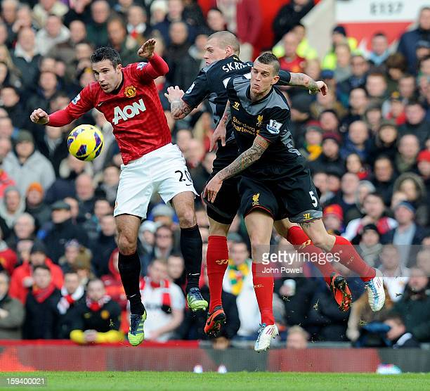 Daniel Agger and Martin Skrtel of Liverpool go up with Robin Van Persie of Manchester during the Barclays Premier League match between Manchester...