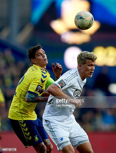 Daniel Agger of Brondby IF and Andreas Cornelius of FC Copenhagen compete for the ball during the Danish Alka Superliga match between Brondby IF and...