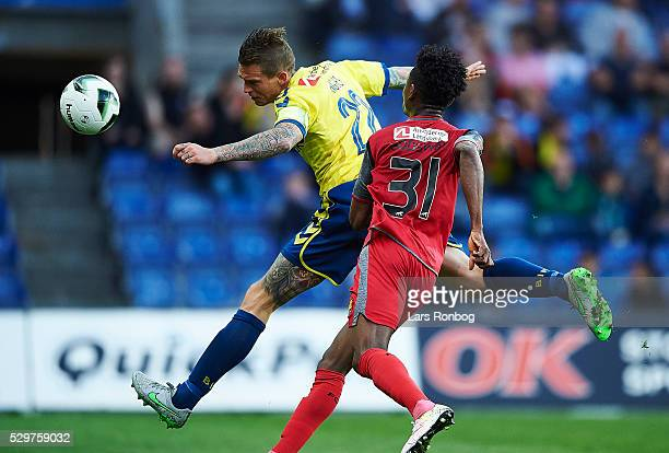 Daniel Agger of Brondby IF and Godsway Donyoh of FC Nordsjalland compete for the ball during the Danish Alka Superliga match between Brondby IF and...