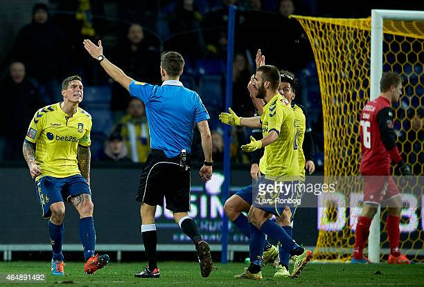 Daniel Agger of Brondby IF reacts against Referee Kenn Hansen during the Danish Alka Superliga match between Brondby IF and FC Midtjylland at Brondby...