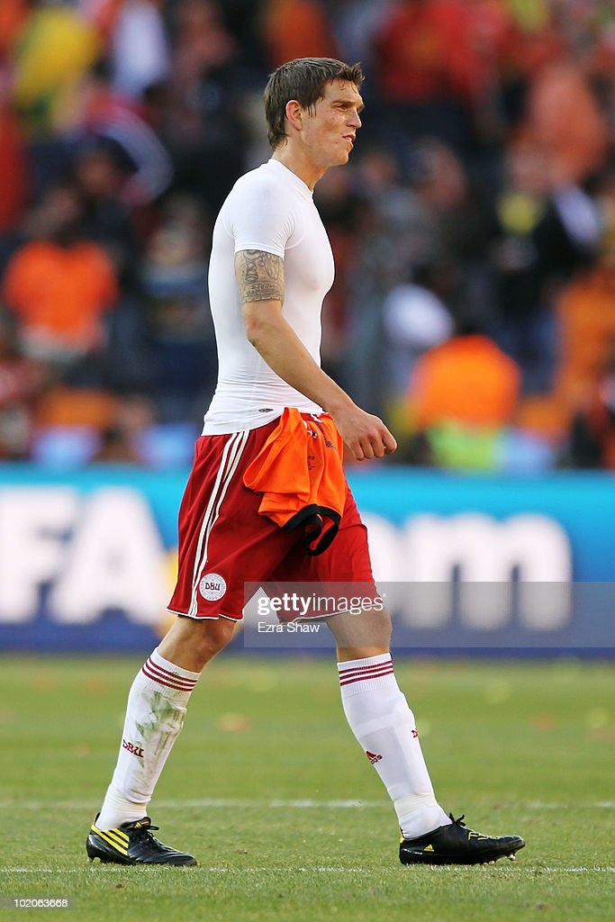 <a gi-track='captionPersonalityLinkClicked' href=/galleries/search?phrase=Daniel+Agger&family=editorial&specificpeople=605441 ng-click='$event.stopPropagation()'>Daniel Agger</a> of Denmark leaves the field dejected after the 2010 FIFA World Cup Group E match between Netherlands and Denmark at Soccer City Stadium on June 14, 2010 in Johannesburg, South Africa.