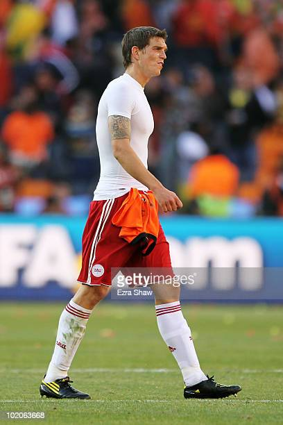 Daniel Agger of Denmark leaves the field dejected after the 2010 FIFA World Cup Group E match between Netherlands and Denmark at Soccer City Stadium...