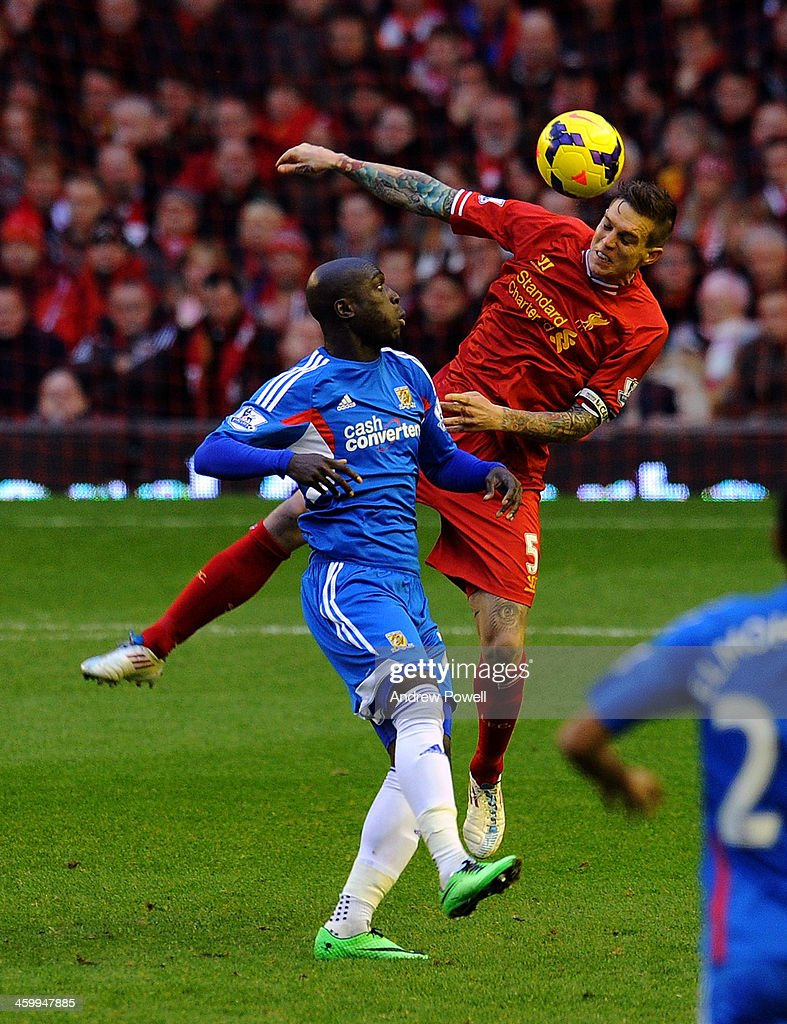 <a gi-track='captionPersonalityLinkClicked' href=/galleries/search?phrase=Daniel+Agger&family=editorial&specificpeople=605441 ng-click='$event.stopPropagation()'>Daniel Agger</a> of Liverpool and <a gi-track='captionPersonalityLinkClicked' href=/galleries/search?phrase=Yannick+Sagbo&family=editorial&specificpeople=6130628 ng-click='$event.stopPropagation()'>Yannick Sagbo</a> of Hull City compete during the Barclays Premier League match between Liverpool and Hull City at Anfield on January 1, 2014 in Liverpool, England.