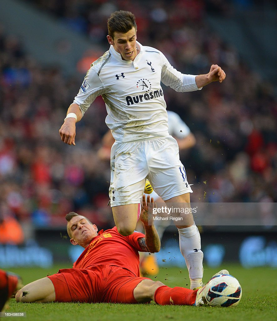 Daniel Agger of Liverpool battles Gareth Bale of Tottenham during the Barclays Premier League match between Liverpool and Tottenham Hotspurs at Anfield on March 10, 2013 in Liverpool, England.
