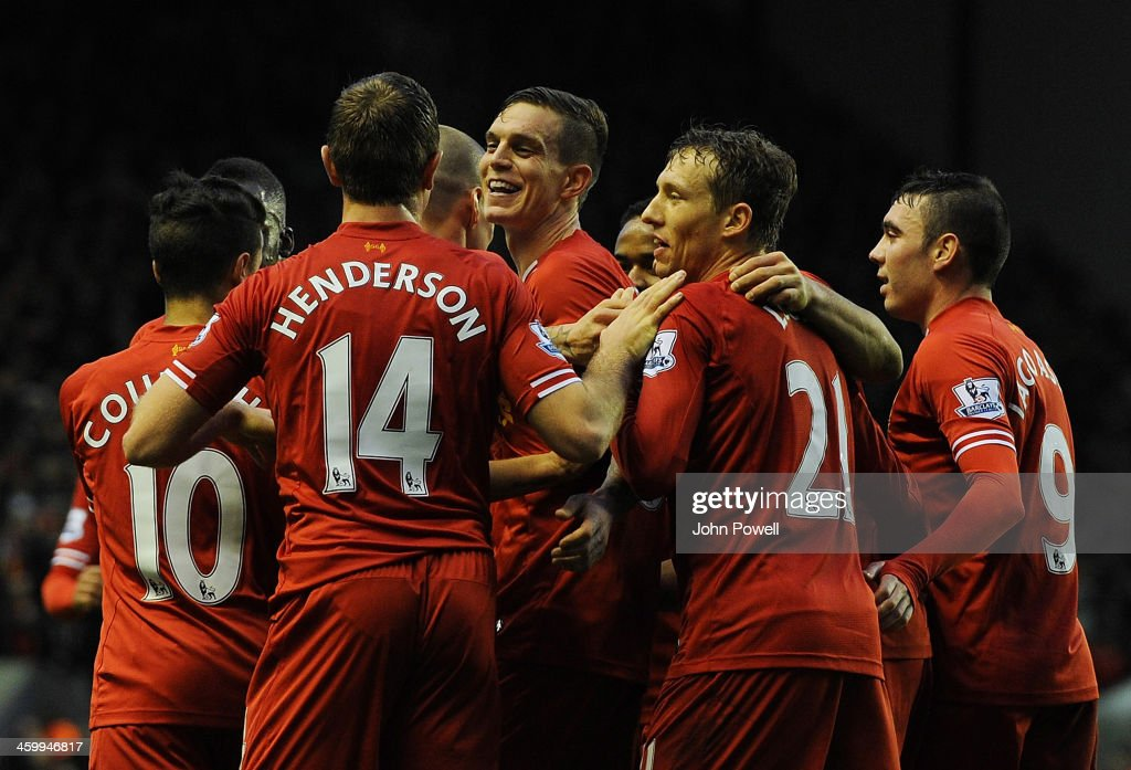 <a gi-track='captionPersonalityLinkClicked' href=/galleries/search?phrase=Daniel+Agger&family=editorial&specificpeople=605441 ng-click='$event.stopPropagation()'>Daniel Agger</a> of Liverpool celebrates his goal during the Barclays Premier League match between Liverpool and Hull City at Anfield on January 1, 2014 in Liverpool, England.