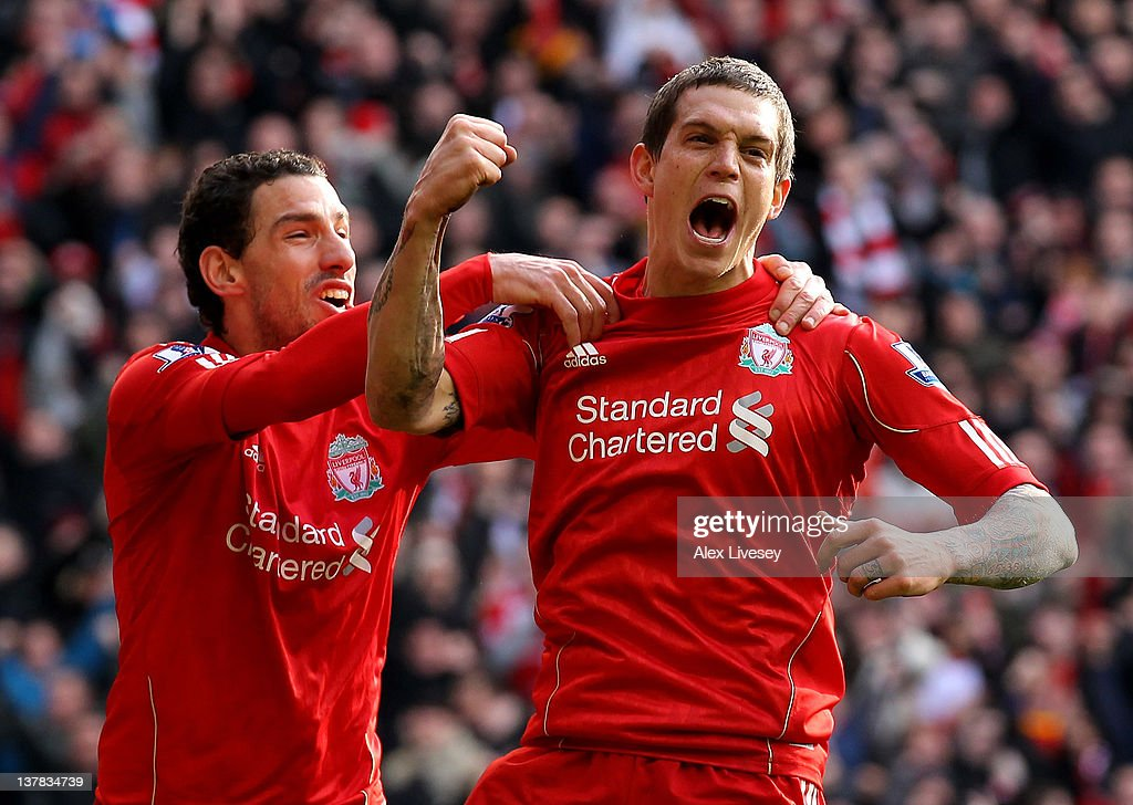 <a gi-track='captionPersonalityLinkClicked' href=/galleries/search?phrase=Daniel+Agger&family=editorial&specificpeople=605441 ng-click='$event.stopPropagation()'>Daniel Agger</a> of Liverpool celebrates scoring the opening goal with Maxi (L) during the FA Cup Fourth Round match between Liverpool and Manchester United at Anfield on January 28, 2012 in Liverpool, England.