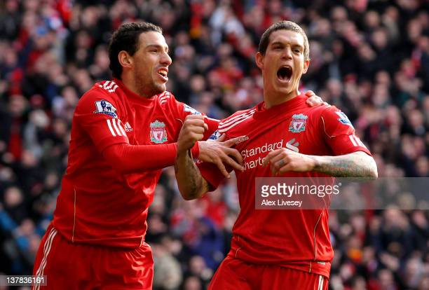 Daniel Agger of Liverpool celebrates scoring the opening goal with Maxi during the FA Cup Fourth Round match between Liverpool and Manchester United...
