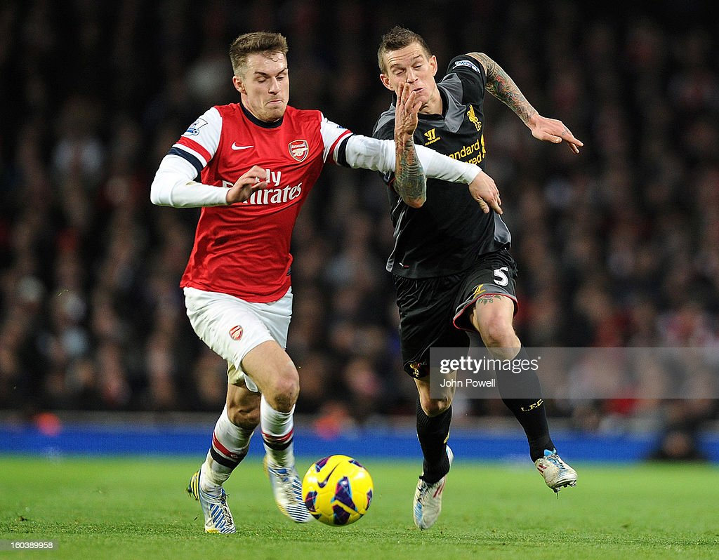 Daniel Agger of Liverpool competes with Aaron Ramsey of Arsenal during the Barclays Premier League match between Arsenal and Liverpool at Emirates Stadium on January 30, 2013 in London, England.