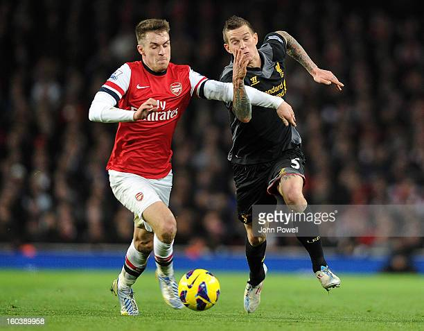 Daniel Agger of Liverpool competes with Aaron Ramsey of Arsenal during the Barclays Premier League match between Arsenal and Liverpool at Emirates...