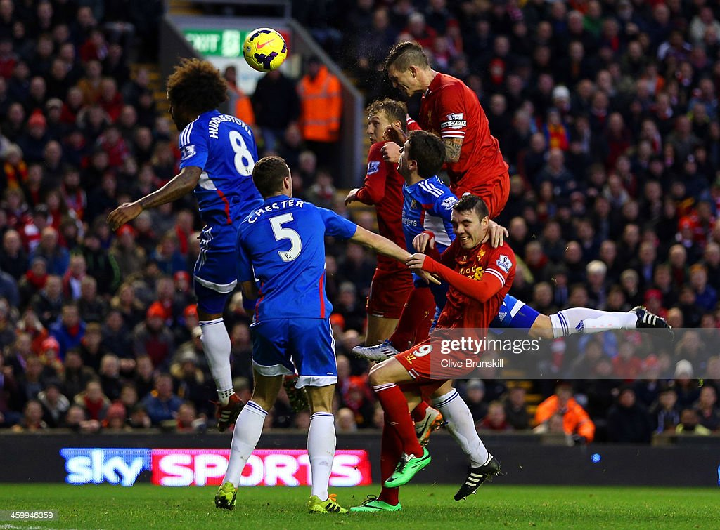 <a gi-track='captionPersonalityLinkClicked' href=/galleries/search?phrase=Daniel+Agger&family=editorial&specificpeople=605441 ng-click='$event.stopPropagation()'>Daniel Agger</a> of Liverpool heads in their first goal past <a gi-track='captionPersonalityLinkClicked' href=/galleries/search?phrase=Tom+Huddlestone&family=editorial&specificpeople=735077 ng-click='$event.stopPropagation()'>Tom Huddlestone</a> of Hull City during the Barclays Premier League match between Liverpool and Hull City at Anfield on January 1, 2014 in Liverpool, England.