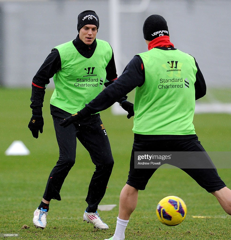 <a gi-track='captionPersonalityLinkClicked' href=/galleries/search?phrase=Daniel+Agger&family=editorial&specificpeople=605441 ng-click='$event.stopPropagation()'>Daniel Agger</a> (L) of Liverpool in action during a training session at Melwood Training Ground on December 20, 2012 in Liverpool, England.